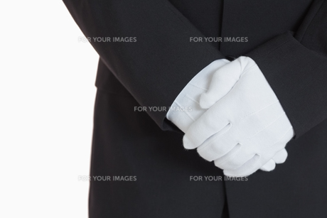 Man with white gloves FYI00486559
