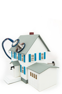 Blue stethoscope taking care of the house FYI00486634