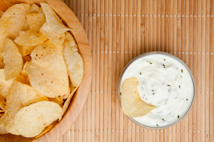A bowl of chips and a bowl of dip side by side FYI00486898
