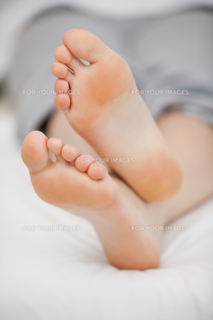 Close-up of the feet of a woman who is lying FYI00487000