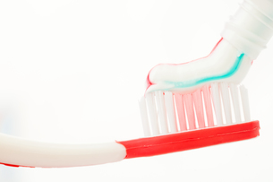 Red toothbrush with multicolour toothpaste FYI00487093