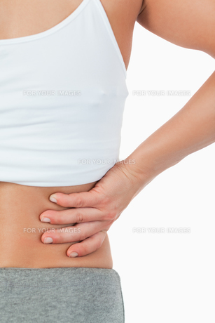 Close up of female with back pain FYI00487482