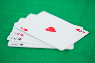 Card game aces on a green backgroundの素材 [FYI00487837]