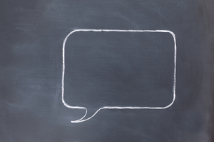 Empty square speech bubble on a blackboard FYI00487855