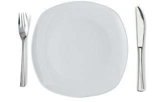 White plate with silver knife and fork FYI00487879