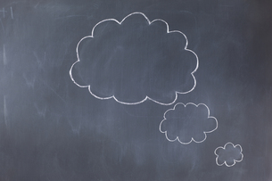 Empty cloud bubbles on a blackboard FYI00488024