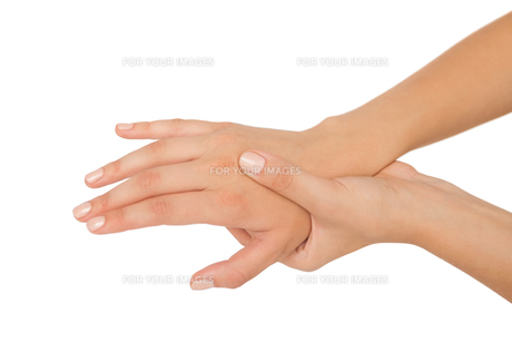 Young woman touching her injured hand FYI00488110