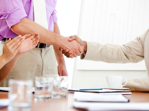 Close up of two business partners closing a deal FYI00488286