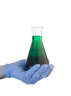 Hand holding out chemicals FYI00488427