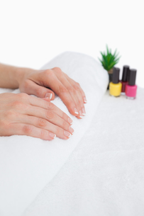 French manicured fingers and nail paint bottles FYI00488673