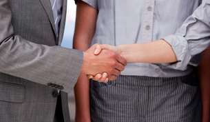 Close up of a lucky Business team closing a deal FYI00488747