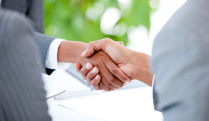 Close up of an agreement between two businesspeople FYI00488773