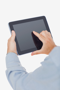 Hands using digital tablet FYI00488777