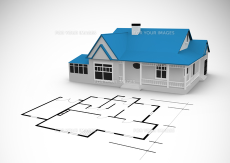 Blue house behind an architectural plan FYI00488789
