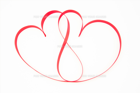 Pink ribbon shaped into intertwining hearts FYI00488795