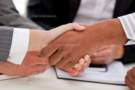 Close up of businesspeople closing a deal FYI00488820