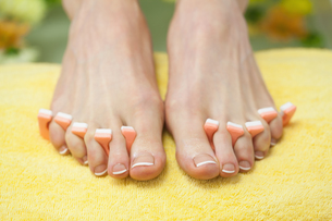 Closeup of french pedicured feet FYI00488844