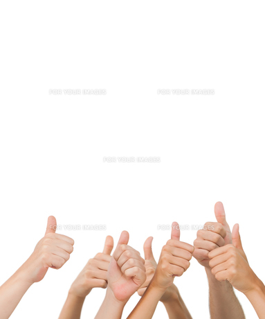 Hands giving thumbs up FYI00488863