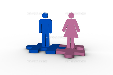 Blue and pink human figures over jigsaw pieces meshed together FYI00488912