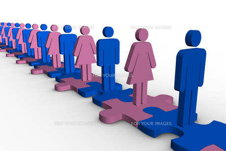 Line of blue and pink human forms standing over meshed jigsaw pieces FYI00488913