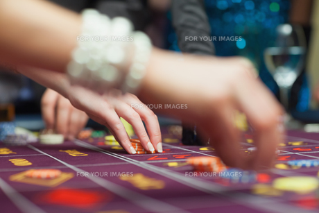 People placing bets FYI00488936
