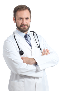 Serious doctor man posing with folded arms FYI00632127