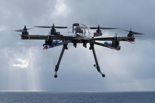 Hexacopter drone flying over the ocean FYI00632180