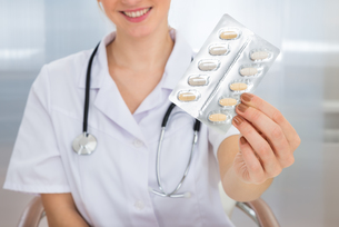Female Doctor Holding Medicine FYI00637186