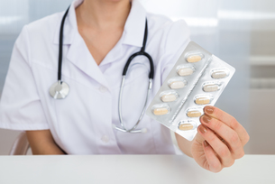 Female Doctor Holding Medicine FYI00637188