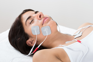 Woman With Electrodes On Her Face FYI00642182