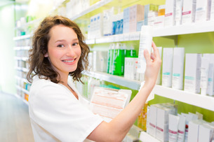 Attractive pharmacist clean the store up FYI00646849