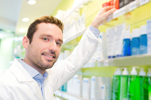 Attractive pharmacist clean the store up FYI00646882