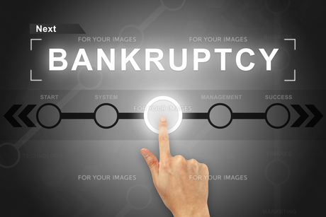 hand clicking bankruptcy button on a screen interface FYI00647517