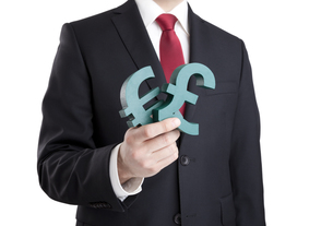 Businessman holding euro and pound signs with clipping path FYI00648887