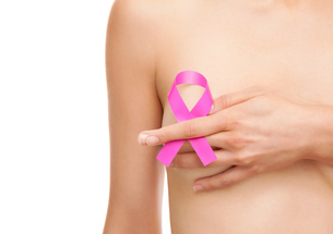 Woman with a breast cancer awareness ribbon FYI00652250