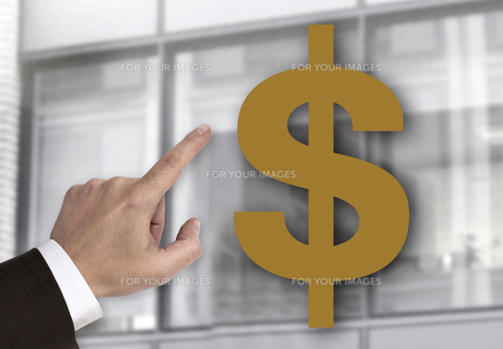hand pointing at dollar sign concept FYI00653003