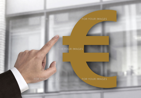 hand pointing at euro sign concept FYI00653007