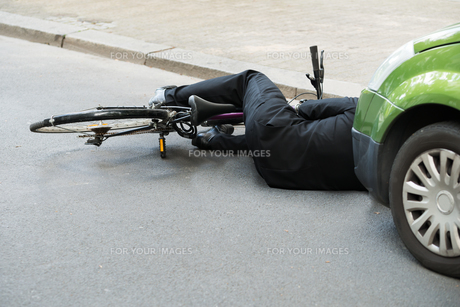 Male Cyclist After Car Accident On Road FYI00654129