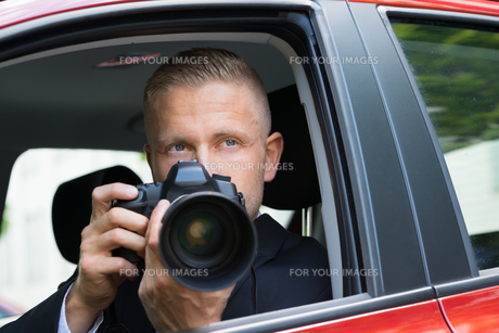 Man Photographing With Slr Camera From Car FYI00654150