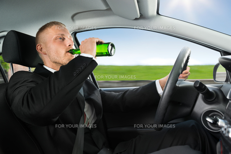 Man Drink's Beer While Driving Car FYI00654181