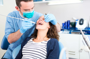Young attractive woman being cured by a dentist FYI00659608
