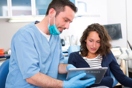 Young attractive woman scared to being cured by a dentist FYI00659613
