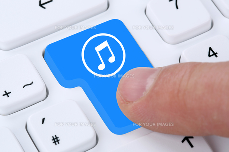 computer concept listening music download streaming and buy on the internet FYI00663190