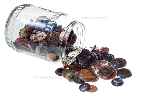 glass jar with sewing buttons isolated FYI00663596