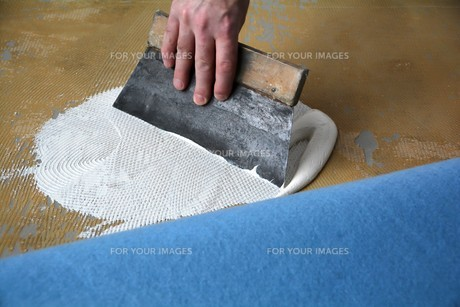 a floorlayer when applying adhesive FYI00667760