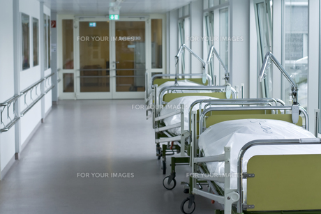 hospital corridor with beds FYI00686983