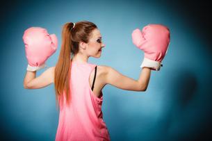 female boxer wearing big fun pink gloves playing sports FYI00706991