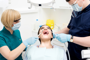 Dental cleaning, woman under treatment. FYI00748963