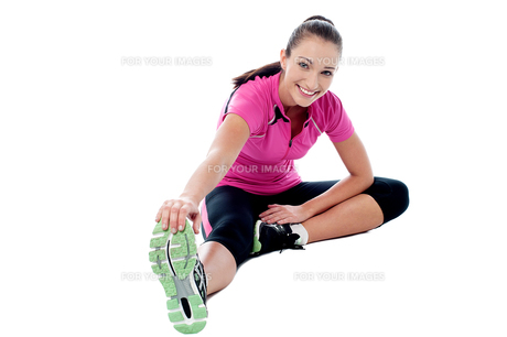 Flexible athletic woman doing stretching FYI00749017