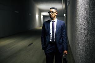 Businessman in tunnel FYI00759714